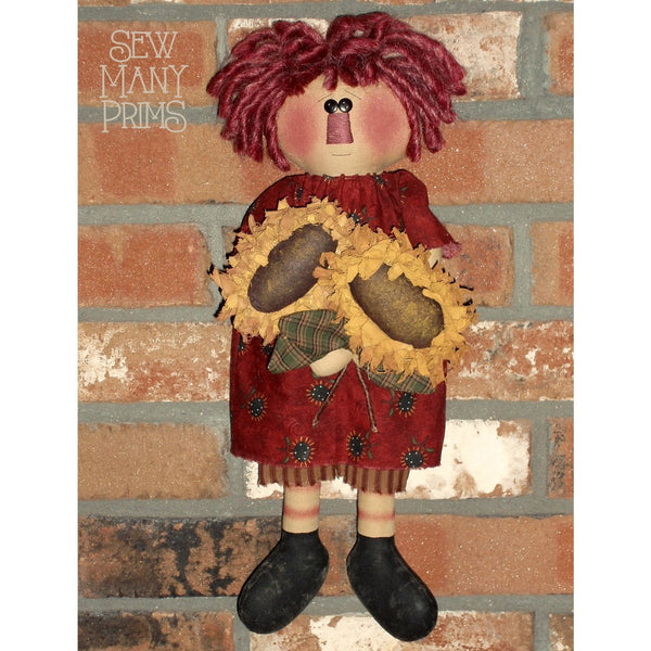 Rag doll holding sunflowers
