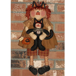 Halloween themed fabric raggedy Annl holding child wearing cat costume