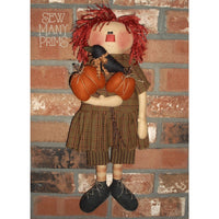 rag doll holding pumpkins & crow