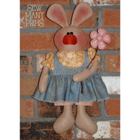 Primitive bunny wearing a jumper & holding a pink flower