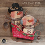 Snowman couple in sleigh