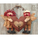Primitive raggedy angels holding a heart