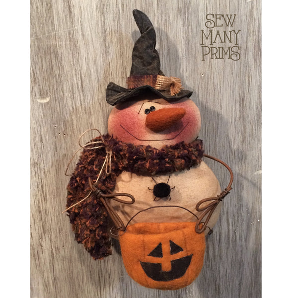 Snowman Ornie dressed as witch holding jack-o-lantern bag