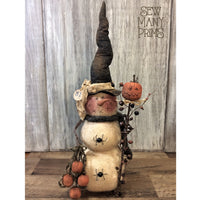 Snowman centerpiece dressed as a witch