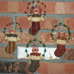 4 mini stocking ornaments stuffed with a snowman, gingerbread man, Raggedy Ann & Andy