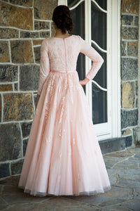 Fully lined. Look like a princess in this soft pink tulle evening gown. Fit and flare style.