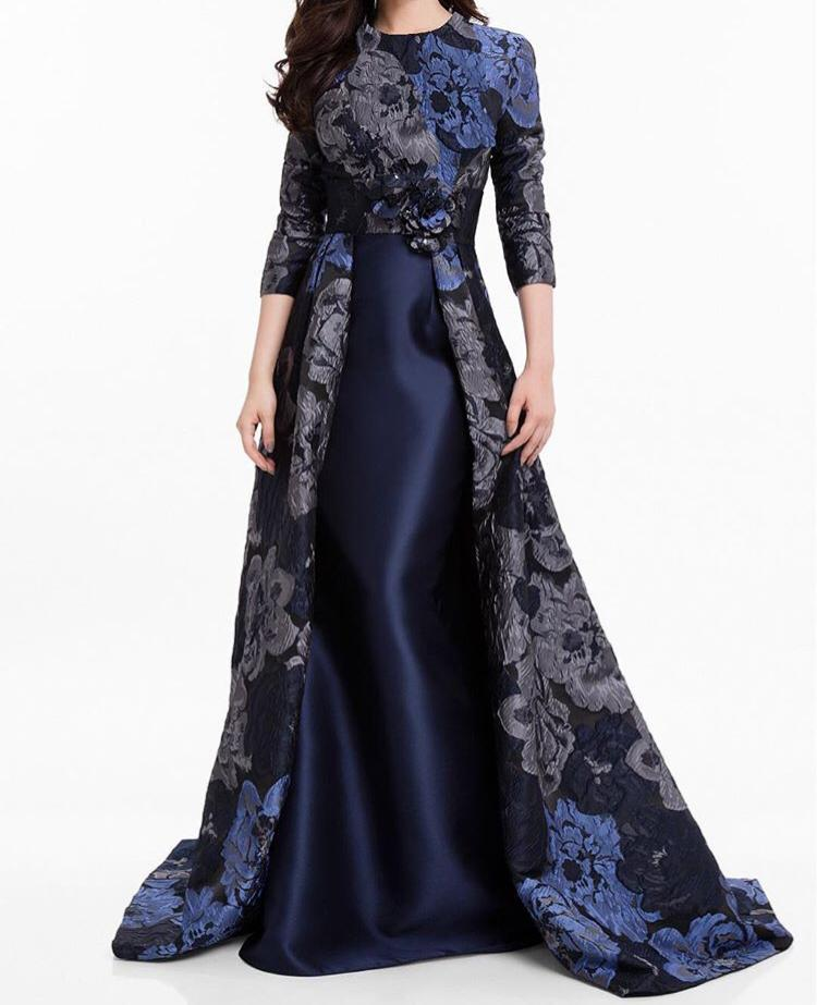 Navy blue modest gown with gray and blue floral skirt cape