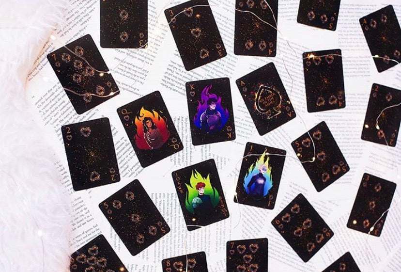 An Ember in the Ashes playing cards with gilded edges