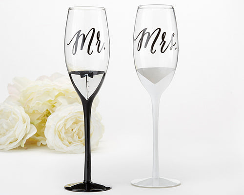 TUXEDO AND WEDDING GOWN MR. & MRS. TOASTING FLUTES
