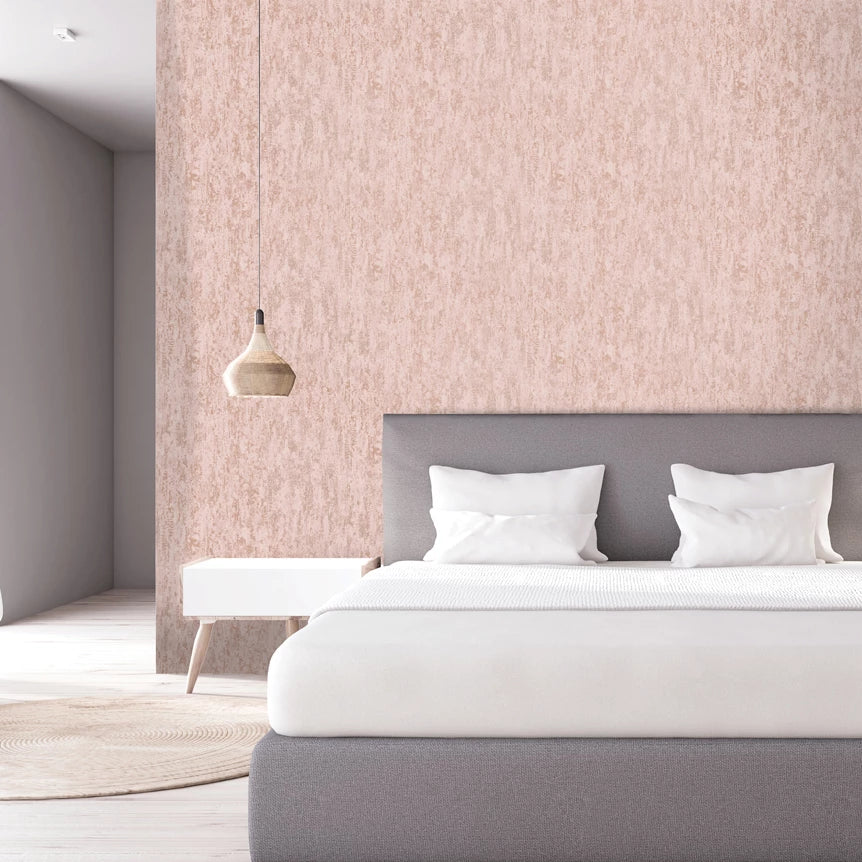Pink and rose gold distressed effect wallpaper in bedroom