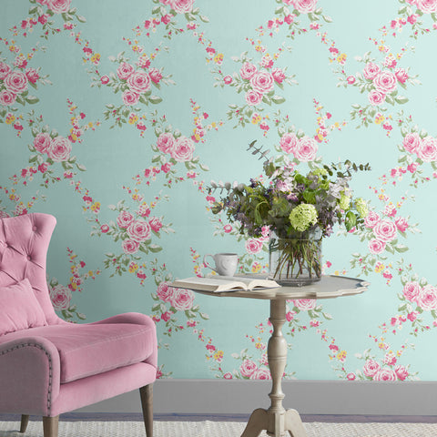 Catherine Lansfield duck egg and pink flower print wallpaper in room