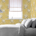 Catherine Lansfield yellow floral wallpaper in bedroom