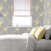Catherine Lansfield grey and yellow floral print wallpaper in room