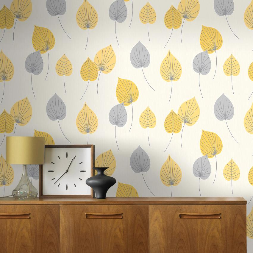 Grey and yellow leaf pattern wallpaper on wall