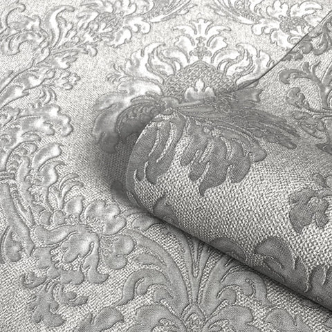Close up of silver grey glitter luxury damask wallpaper