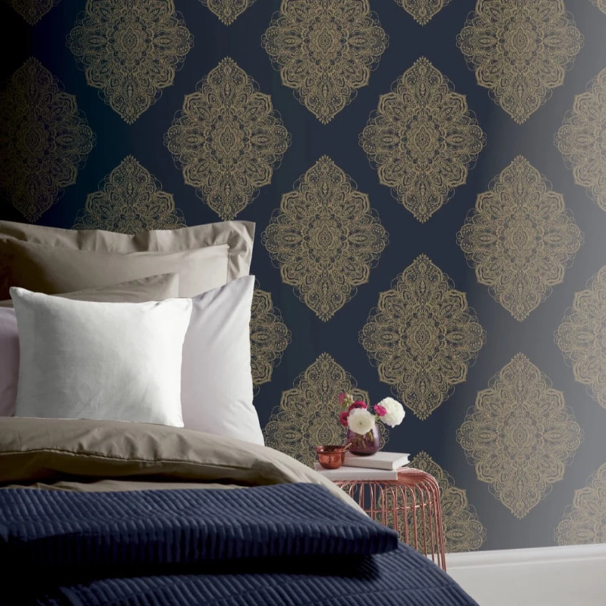Metallic gold damask on purple blue wallpaper in bedroom