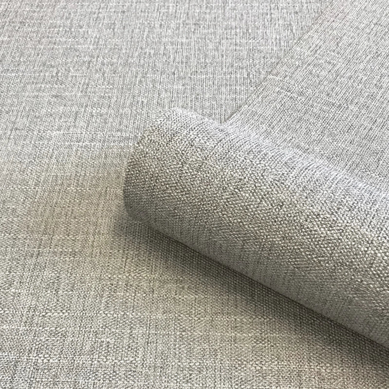 Close up of silver grey luxury fabric effect wallpaper