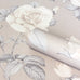 Close up of beige and taupe rose flower wallpaper