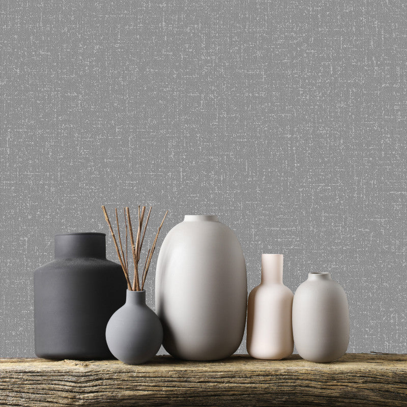 Charcoal grey textured plain wallpaper with silver glitter in room