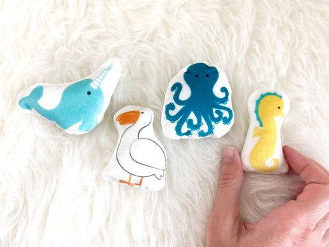 narwhal, pelican, octopus, and seahorse plush set
