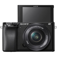"Sony Alpha a6100 Mirrorless Digital Camera with 16-50mm and 55-210mm Lenses and Striker Deluxe Bundle with 12"" Tripod"