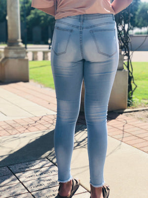 Light Washed Mid Rise Distressed Jeans