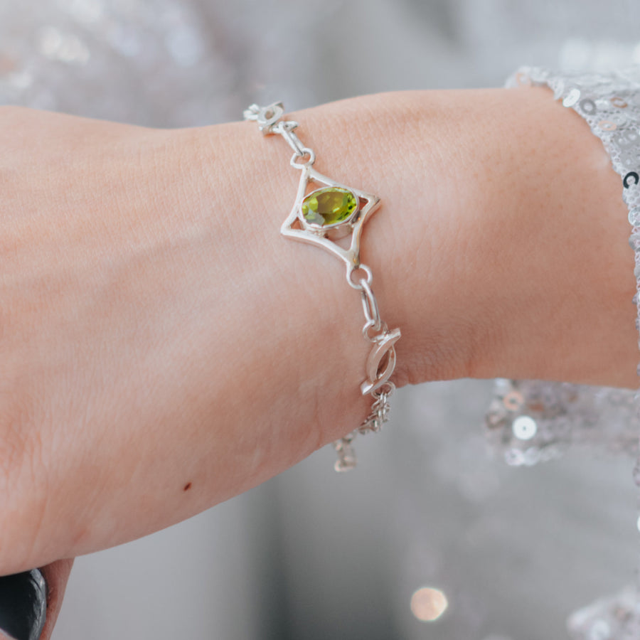 north star peridot healing gemstone bracelet on wrist
