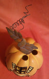 HAUNTED HOUSE PUMPKIN VOTIVE HOLDER