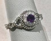 Round Amethyst and Diamond Halo Twist Ring