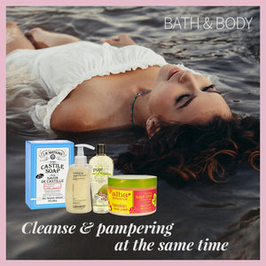 lady laying down on water next to bath and body products