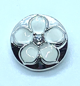 White Enamel Flower set in Sliver with a Crystal