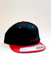 Luxey cap snapback black/red