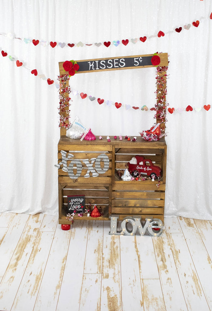 Kate White Curtain Kisses booth Valentine's Day Backdrop Designed by Leann West