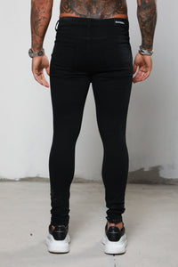 Surreal Ripped & Repaired Skinny Jeans - Black