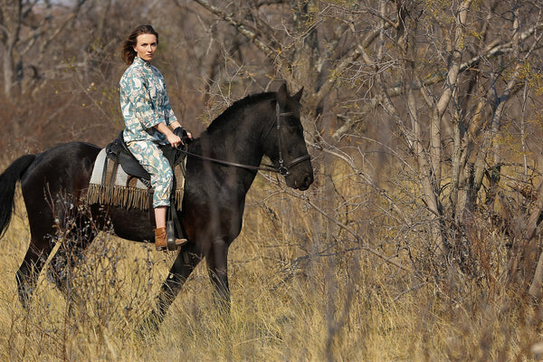 C. St. Quinton Pyjamas, photo of the founder wearing the pyjamas whilst on horseback in the South African bush