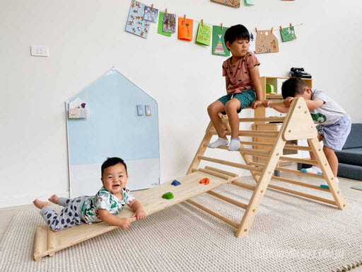 MOOV Baby Rock Climbing Ramp Slide and Pikler Folding Triangle. Copyright: Oskar's Wooden Ark
