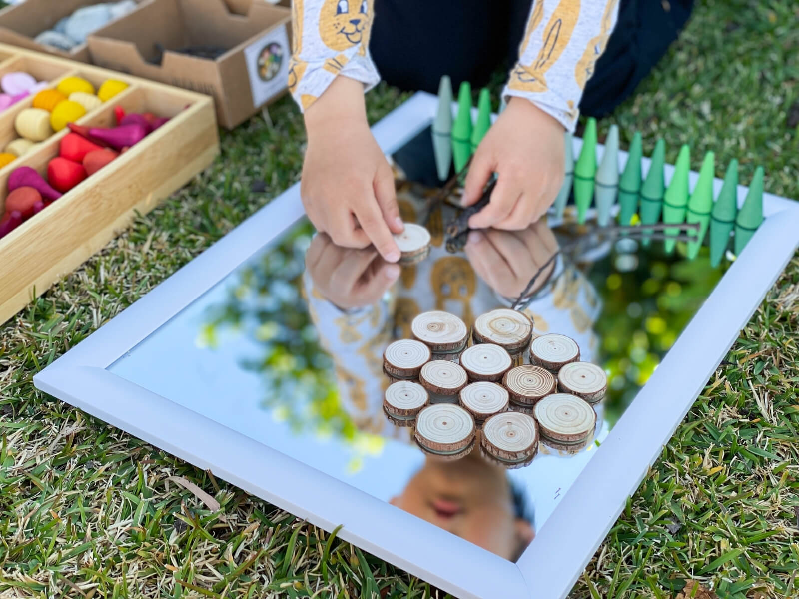 Invite children to create transient art with the loose parts