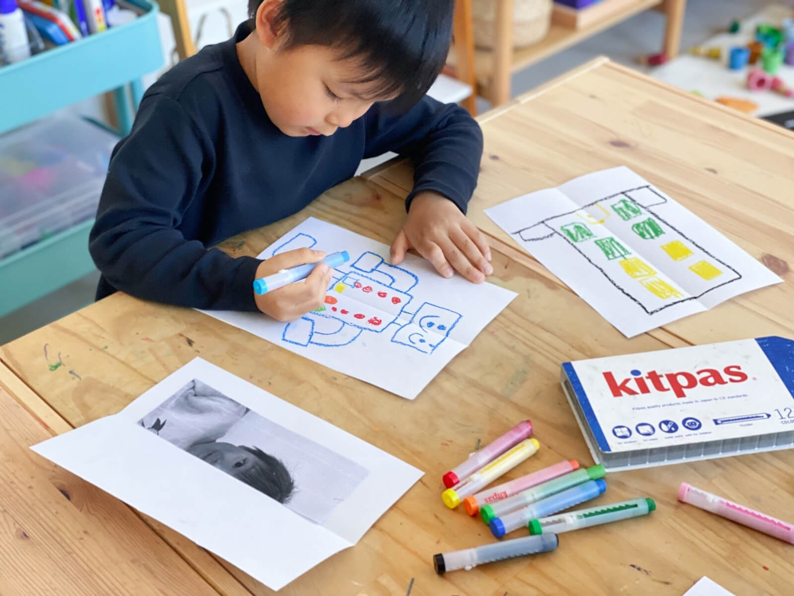 Kids can add their own detail to create the symmetrical picture