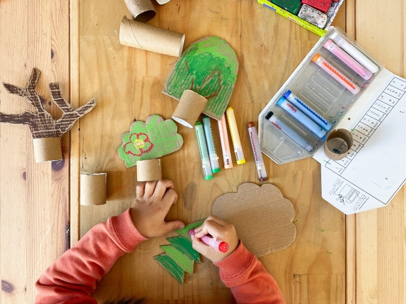 Colour and decorate the tree shapes with crayons or paint. We used our Kitpas art crayons.