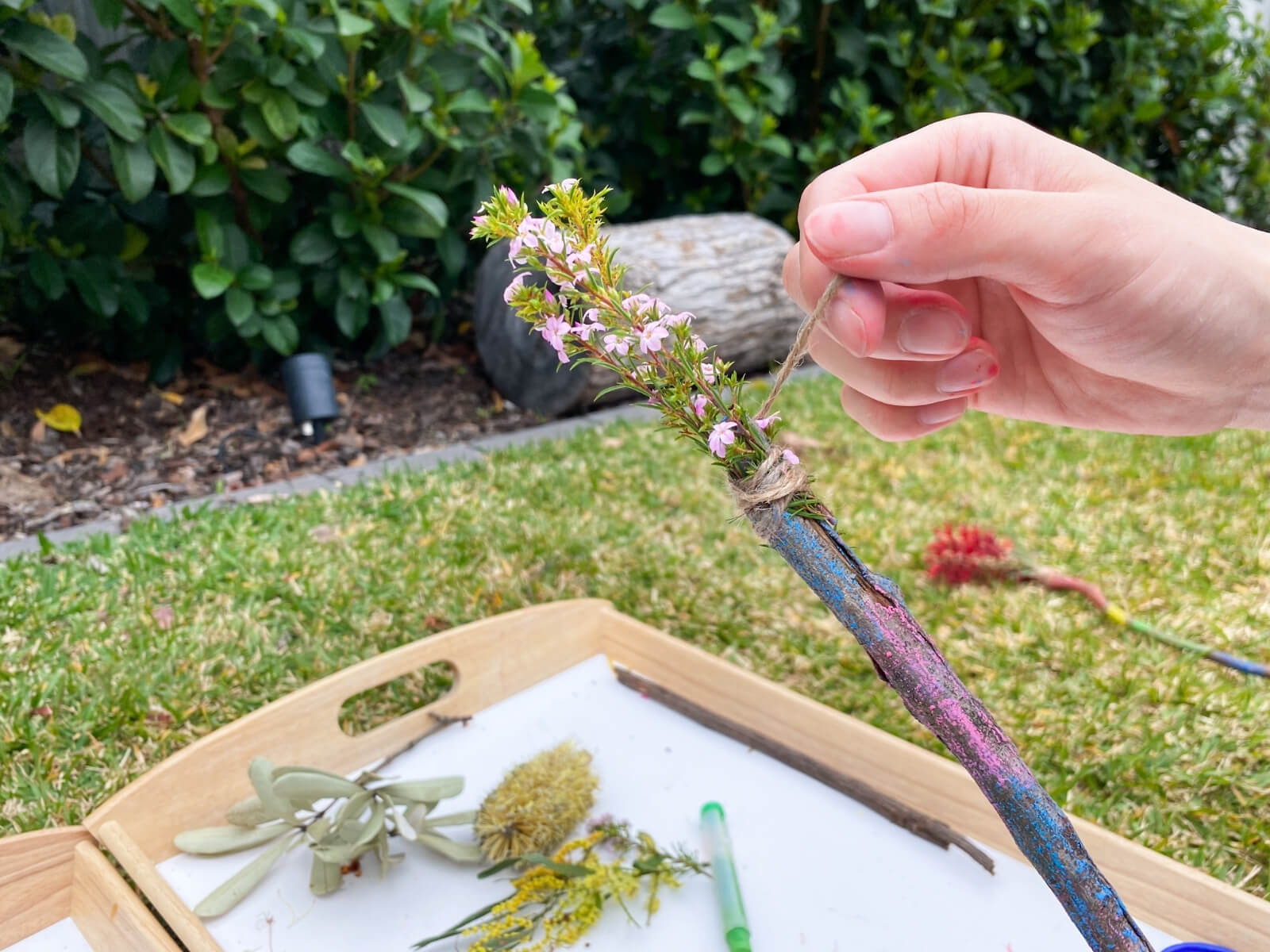 wrap the leaves and flowers around the stick