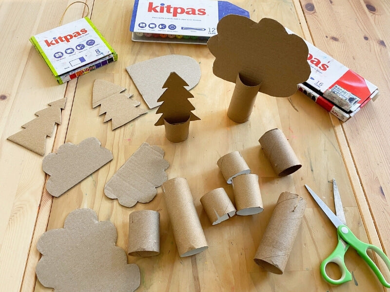 Cut out trees in different shapes and sizes.