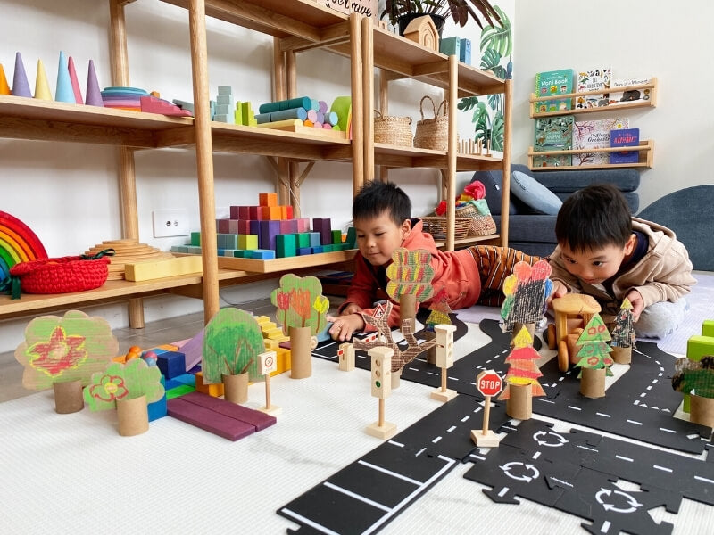 Use your cardboard forest for small world and imaginative play!