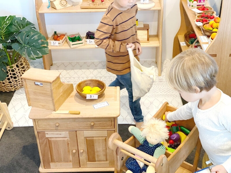 Playing shops with Drewart wooden shopping trolley