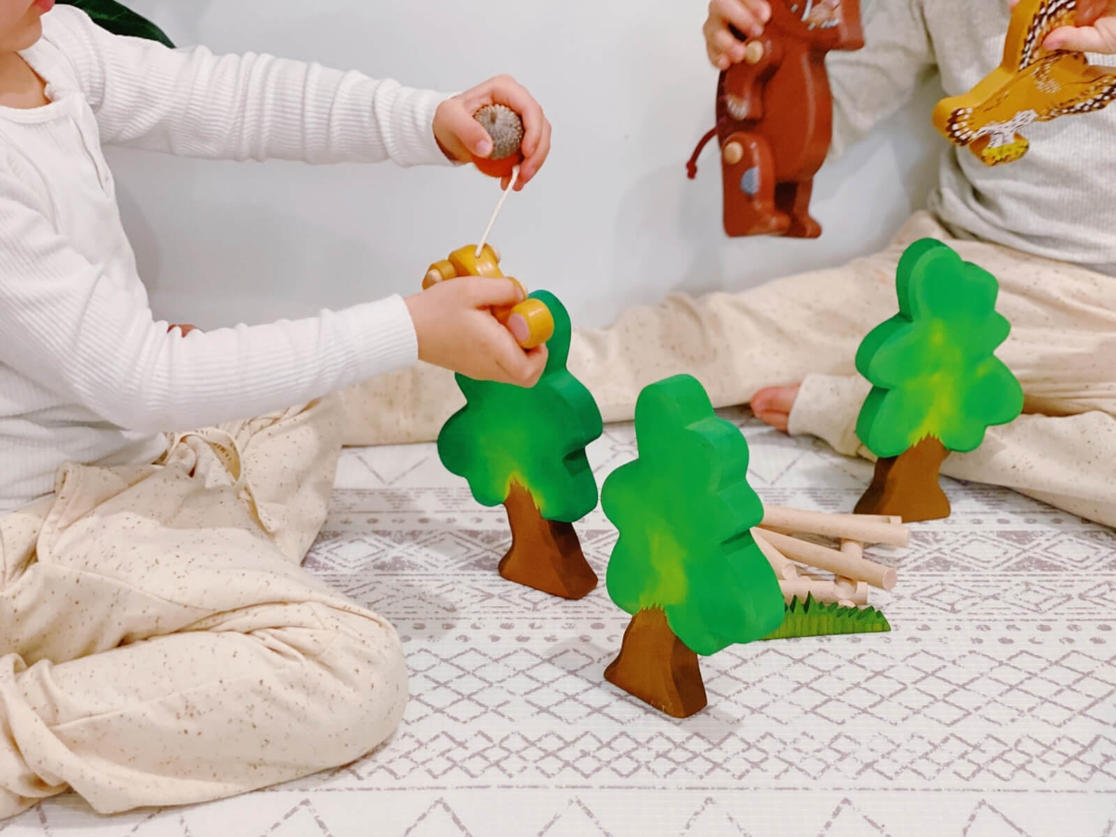 Retelling the story of The Gruffalo using the figurines and other small world play items