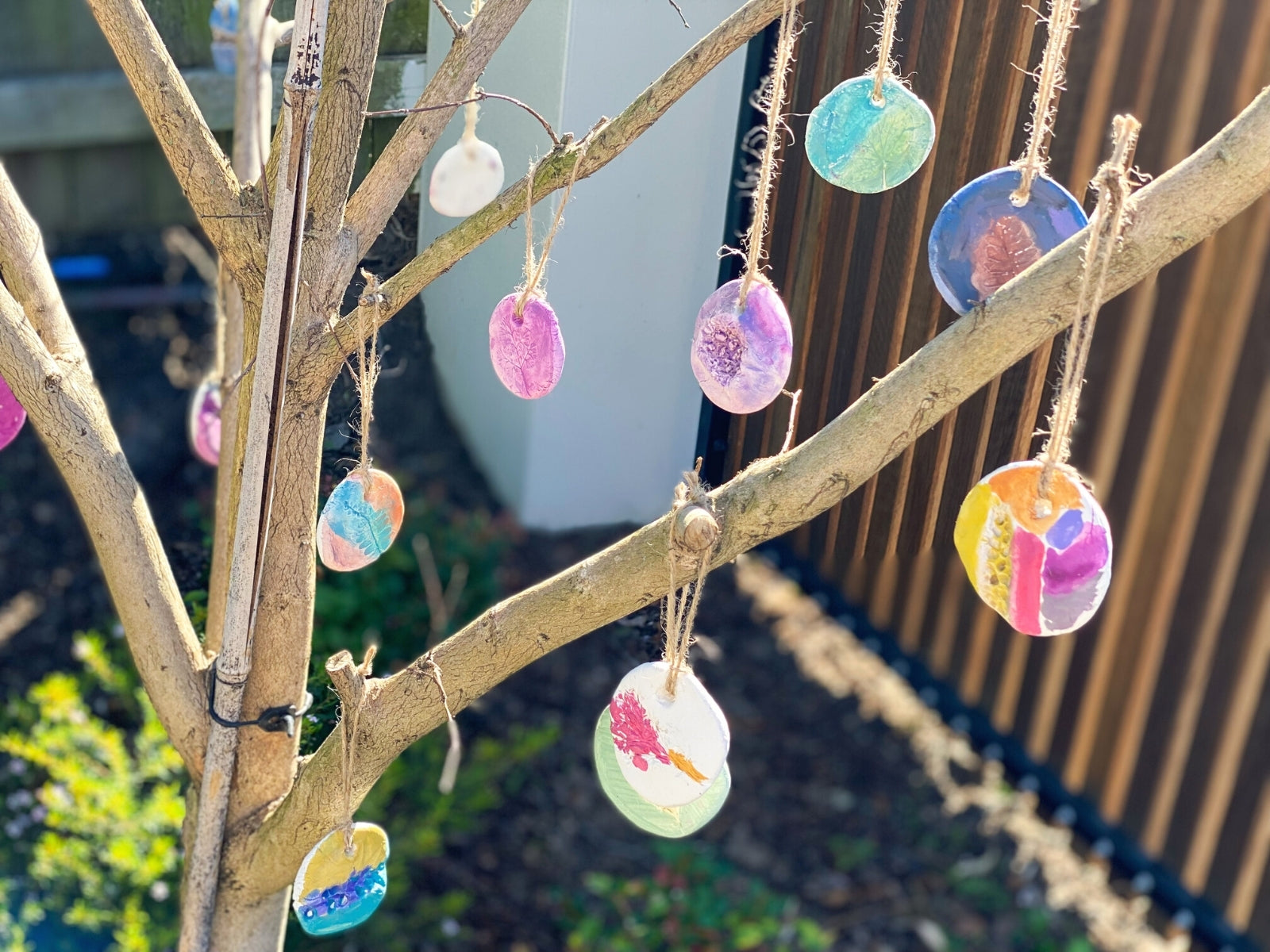 Use twine to hang up your nature clay ornaments. Why not decorate a tree or a few loose branches in celebration of Spring?