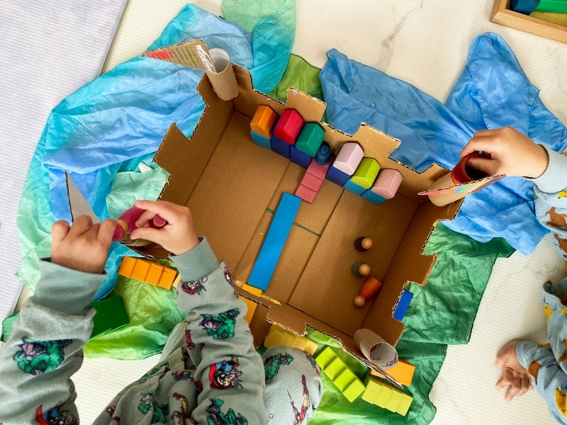 Set up your cardboard castle for small world play.