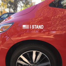 "White ""I STAND"" decal in red background."