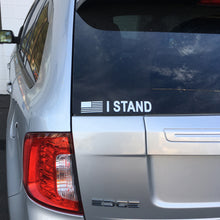 "White ""I STAND"" decal in grey background"