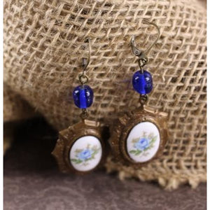 Blue Rose Cameos on Chocolate Brass