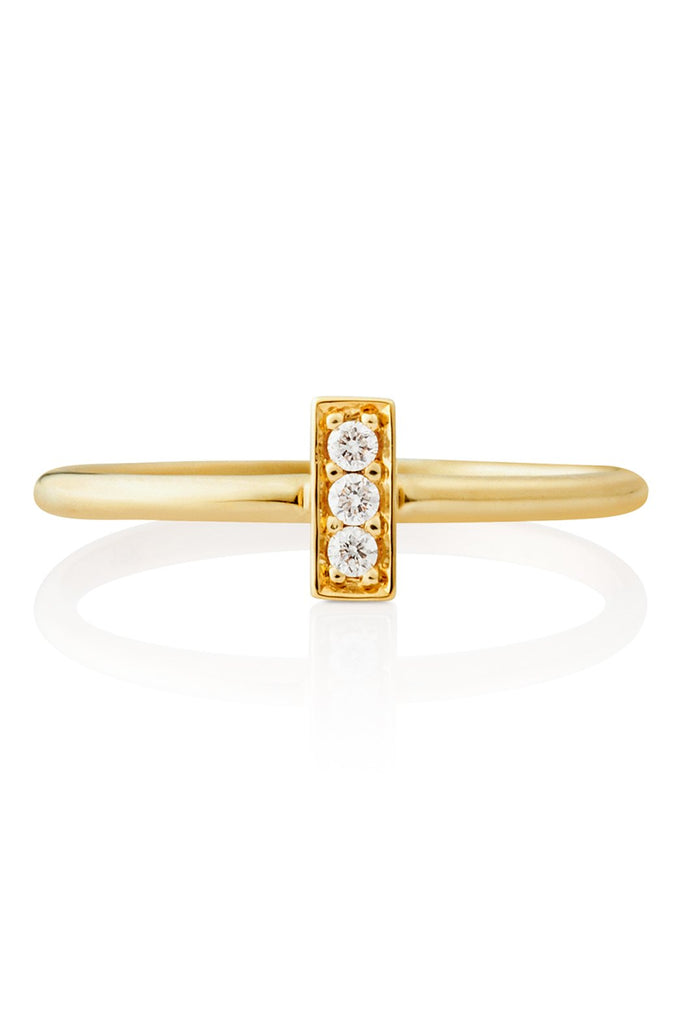 Our striking, clean look bar ring elongates the finger and highlights a line of 3 fine diamonds framed in gold.